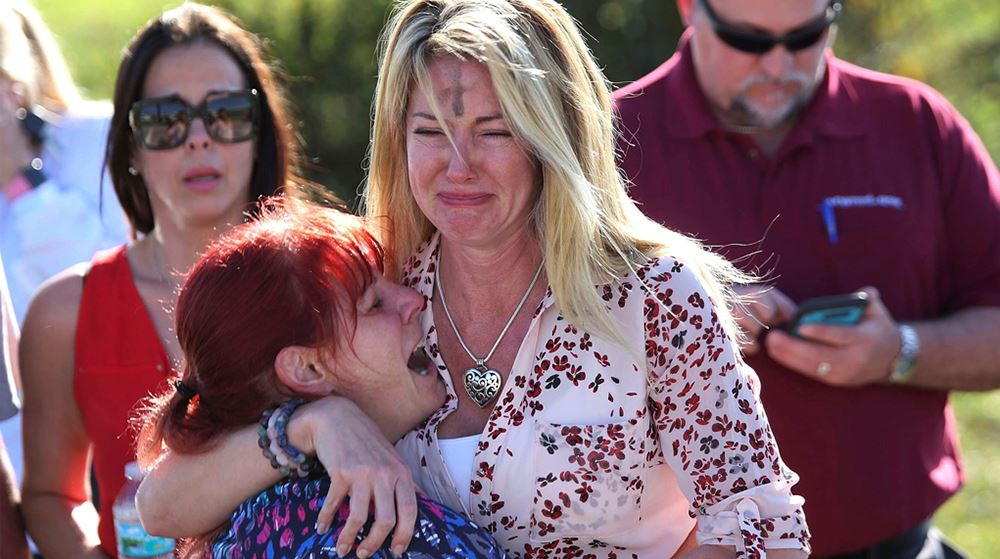 Parents wait for news after a reports of a shooting at Marjory Stoneman Douglas